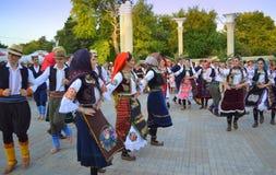 Serbian folk dancers at parade. Serbian folk dancers dressed in national costumes at 23rd International Folklore Festival street Parade,Varna, Bulgaria.August stock photos