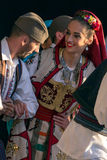 Serbian folk dancers perform in a show 1. ROMANIA, TIMISOARA - JULY 7, 2016: Young Serbian dancers in traditional costume, perform folk dance during Royalty Free Stock Photos