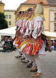 Serbian folklore. Dancing girls from Serbia in traditional clothes. Folklore festival in Klatovy, Czech Republic, summer 2009 Royalty Free Stock Photography