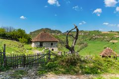 Serbian household on the mountain. Village house and wooden fence.  stock images