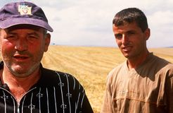 Serbian men in Kosovo. Serbian men stood in a field in Kosovo stock photography
