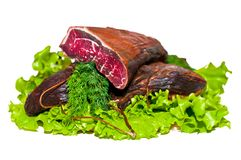 Serbian national smoked beef. On salad lists. Prsut stock image