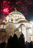 Serbian New years eve celebration. BELGRADE - JANUARY 13: Serbian New years eve celebration in front of the St. Sava's temple with fireworks at midnight in Stock Photos