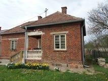 Serbian old house in Smederevo. Rnroof, fence, window, grass, green, rntree, treetop, sky, lawn, sod, sward stock photo