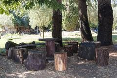 Table and chairs made of stumps and natural material in the park stock photo