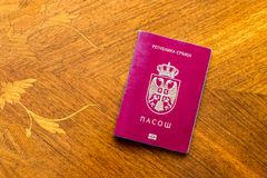 Serbian passport on a wooden table. Serbia royalty free stock photos