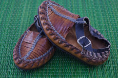 Serbian peasant shoe on green background Stock Images