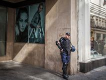 Serbian policeman standing in front of a fashion store with anti riot gear in the center of Belgrade, Serbia, during Gay Pride. BELGRADE, SERBIA - SEPTEMBER 17 royalty free stock photography