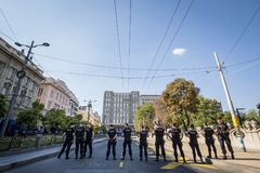 Serbian policemen protecting the 2018 Belgrade Gay Pride wearing anti riot gear in the center of the capital city of Serbia royalty free stock photo