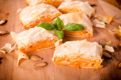 Serbian pumpkin pie. Traditional Serbian pumpkin pie. Selective focus on the front slice of pie royalty free stock photo