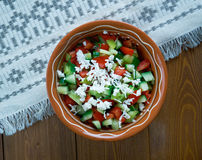 Serbian Salad. Vegetable salad made from diced fresh tomatoes, cucumber,feta and onions royalty free stock image