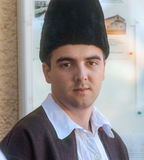 Serbian shepherd in traditional costume at a folk festival Royalty Free Stock Photography