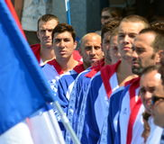 Serbian team listening the national anthem. Royalty Free Stock Photo