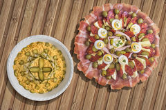 Serbian Traditional Appetizer Savory Dish Meze with Bowl of Olivier Salad set on Bamboo Place Mat Royalty Free Stock Photo