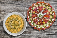 Serbian Traditional Appetizer Savory Dish Meze with Bowl of Olivier Salad set on Old Cracked Wood Background Stock Photos