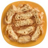 Serbian Traditional Cheese Roll Pie Gibanica Slices Offered On Yellow Ceramic Plate Isolated On White Background.  royalty free stock image