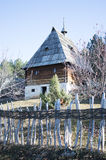 Serbian traditional country house. Serbian traditional rural house behind wooden fence stock photos