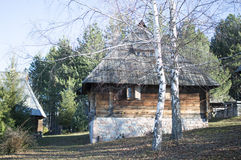 Serbian traditional country house. Serbian traditional rural house behind wooden fence stock photography
