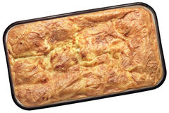 Traditional Serbian Crumpled Cheese Pie Gibanica In Heavy Duty Enameled Baking Pan Isolated On White Background. Freshly baked Serbian Traditional cheese Royalty Free Stock Images