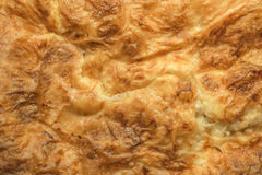 Freshly Oven Baked Serbian Gibanica Crumpled Cheese Pie Golden Crispy Crust Detail. Freshly oven baked Serbian traditional domestic welcome treat, the crumpled Royalty Free Stock Photo