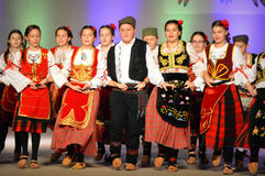 Serbian Youth Dancers. The Serbian youth dancers perform on the All Nations Theater at the Holiday Folk Fair International located in the Wisconsin Exposition stock photo