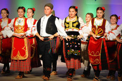 Serbian Youth Dancers. The Serbian youth dancers perform on the All Nations Theater at the Holiday Folk Fair International located in the Wisconsin Exposition stock image