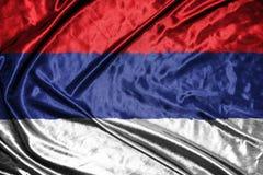 Serbien flagga flagga på bakgrund Royaltyfri Foto
