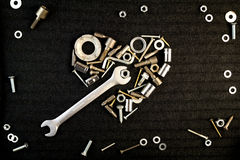 Serce śrub dokrętki i narzędzia Obrazy Stock