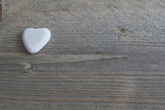 Serce kamień na drewnianym tle Obraz Stock