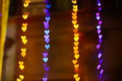 Serce kształtował bokeh żółtego purpurowego błękit coloured przygotowywającym dla twój projekt narzuty Zdjęcia Royalty Free