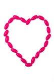 Serce kształtował czerwone medyczne pigułki i kapsuły, opieki zdrowotnej pojęcie Obrazy Royalty Free