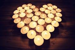 Serce kształtował z świeczkami, walentynka dnia skład Fotografia Stock