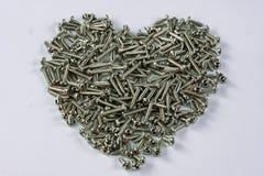 Serce kształtujący stali nierdzewnej śruby tło zdjęcie stock