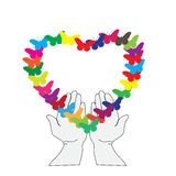 Serce motyle w ich rękach Zdjęcia Royalty Free