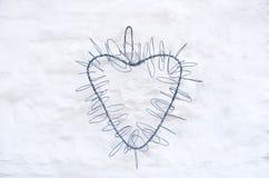 Serce na biel ścianie Zdjęcia Stock