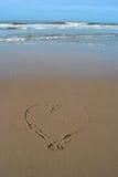 Serce pisać w piasku przy plażą Obraz Royalty Free