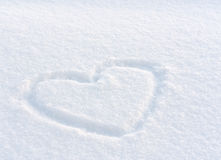 Serce rysujący w śniegu Obrazy Stock