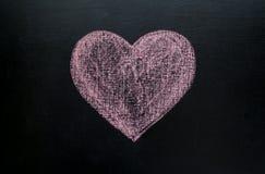 Serce rysujący w kredzie na czarnym chalkboard Zdjęcie Stock