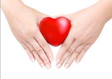 Serce w odizolowywać rękach Zdjęcie Stock