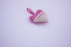 Serce w postaci poduszek na śniegu Obraz Royalty Free