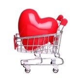 Serce w wózek na zakupy pojęciu odizolowywającym na białym tle Zdjęcia Royalty Free