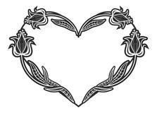 Sercowata czarny i biały rama z kwiecistymi sylwetkami Zdjęcie Royalty Free