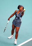 Serena Williams serves at Open GDF Suez Stock Photos
