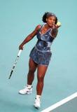 Serena Williams serves at Open GDF Suez stock photos