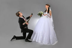 Serenade. Groom is singing serenade for his sweet one bride royalty free stock images