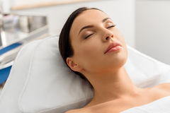 Serene attractive woman leaning in hospital bed Stock Photos