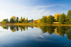 Serene autumn waterscape beautiful colors Stock Image