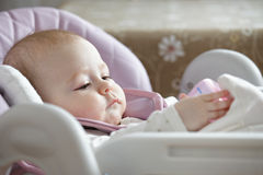 Serene baby in a stroller Stock Photos
