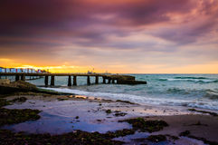 Serene Bay Sunset Environment. A serene and peaceful sunset atmosphere on a seaside with a bay on the horizon and clouds above the autumn sky Stock Images