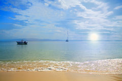 Serene Beach. Beautiful serene beach at sunset, calm sea Royalty Free Stock Photo